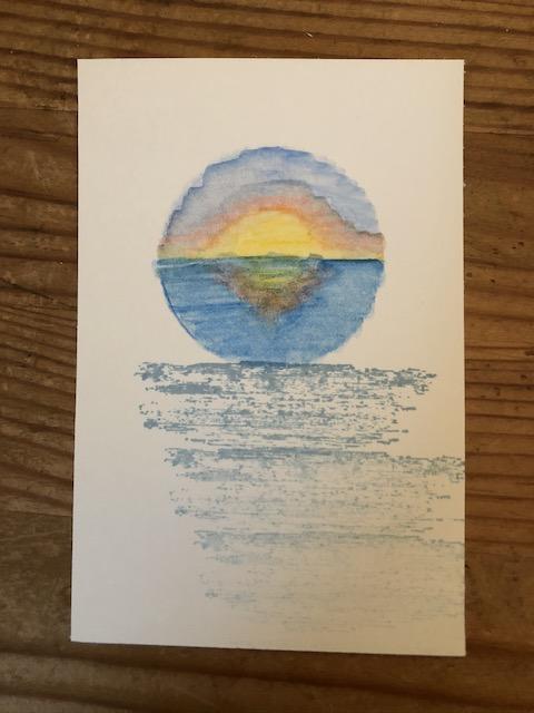 Grußkarte mit Sonnenuntergang, der erst mit den Aquarellstiften von Stampin' Up gemalt wurde und dann mit einem Wassertankpinsel in Form gebracht wurde.
